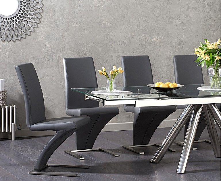 The Camilla 180cm Extending Gl Dining Table With Hampstead Chairs Extends To Seat 10 Stunningly Polished Stainless Steel Legs In A Pedestal Design