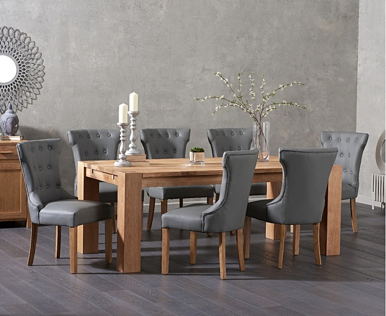 The Madrid 200cm Solid Oak Dining Table With Camille Grey Faux Leather Chairs Seats 8 Diners Discreet Finger Jointing And An Oil Finish
