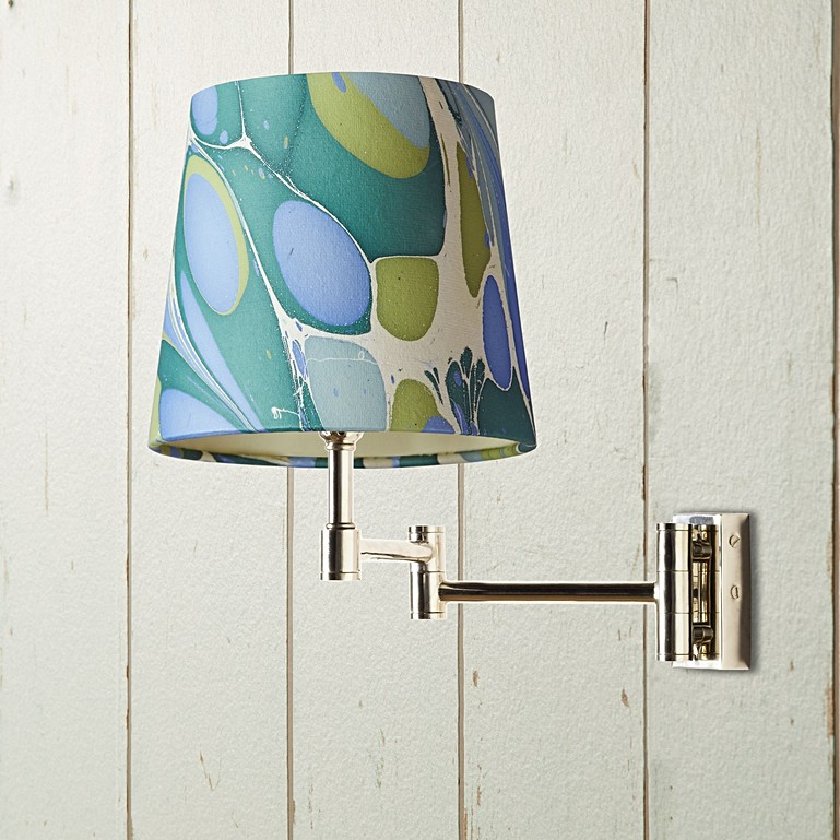 Cagney wall fitting in chrome with a 20cm tall tapered hand made marbled  paper shade in green and blue roya